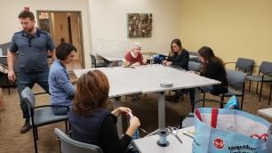 East Boston community members assisting the art team
